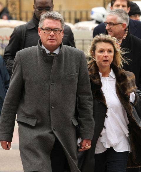 The deputy editor of The Sun, Geoff Webster, arrives at Westminster Magistrates' Court in London with his wife Alison