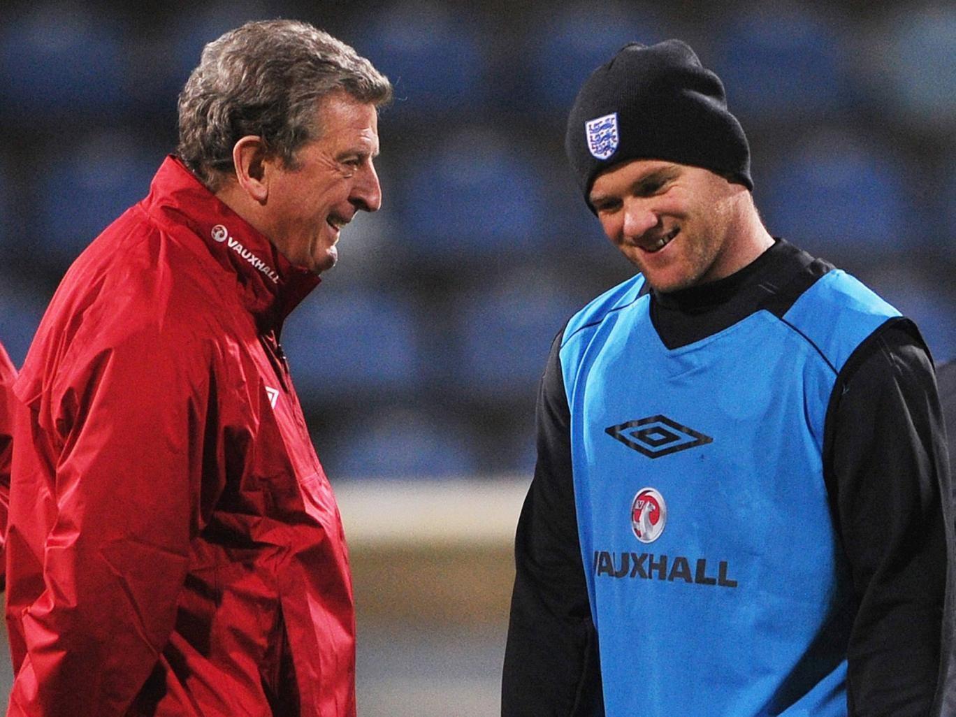 Roy Hodgson talks to Wayne Rooney