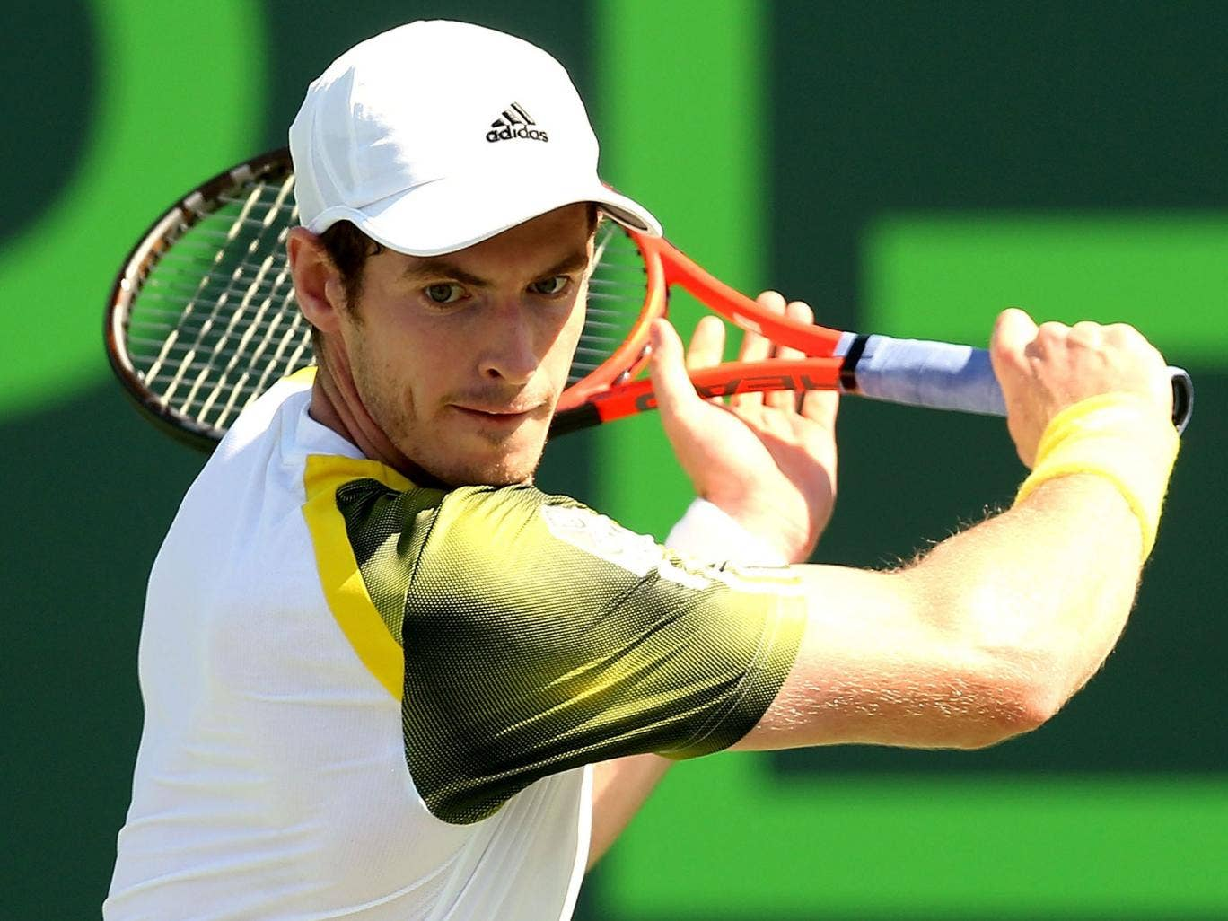 Andy Murray hits a return during his victory over Andreas Seppi