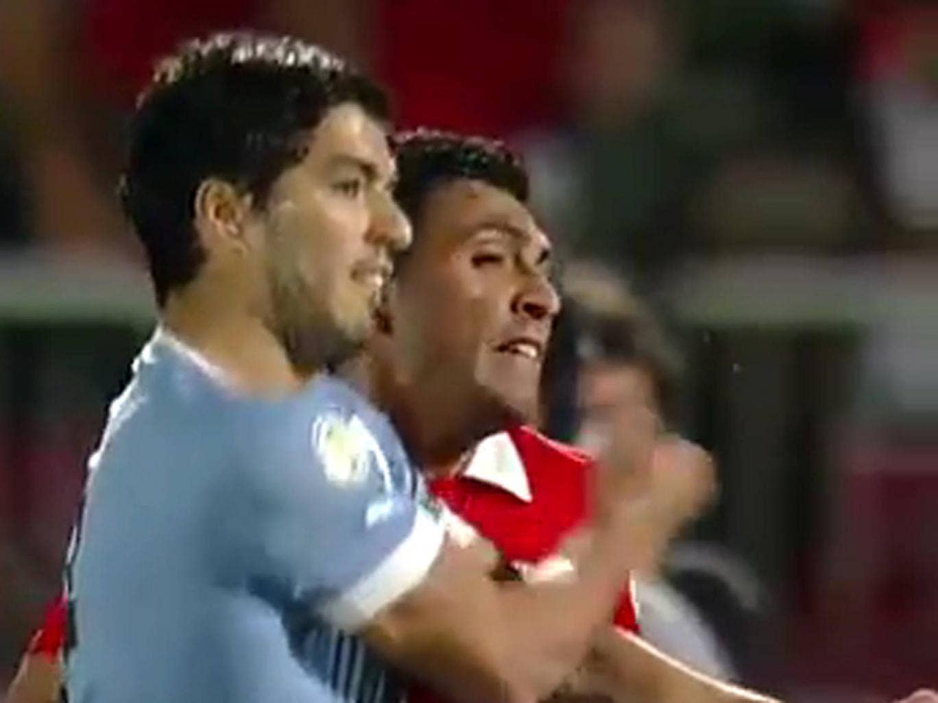 Suarez punches his Gonzalo Jara during Uruguay's defeat against Chile