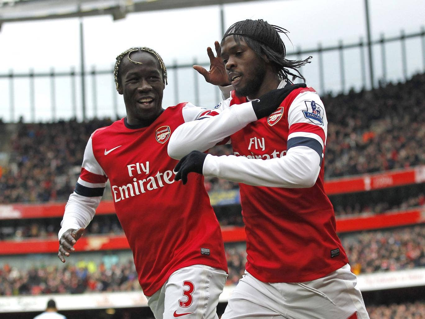 Arsenal's Ivorian striker Gervinho (R) celebrates scoring the opening goal with French defender Bacary Sagna