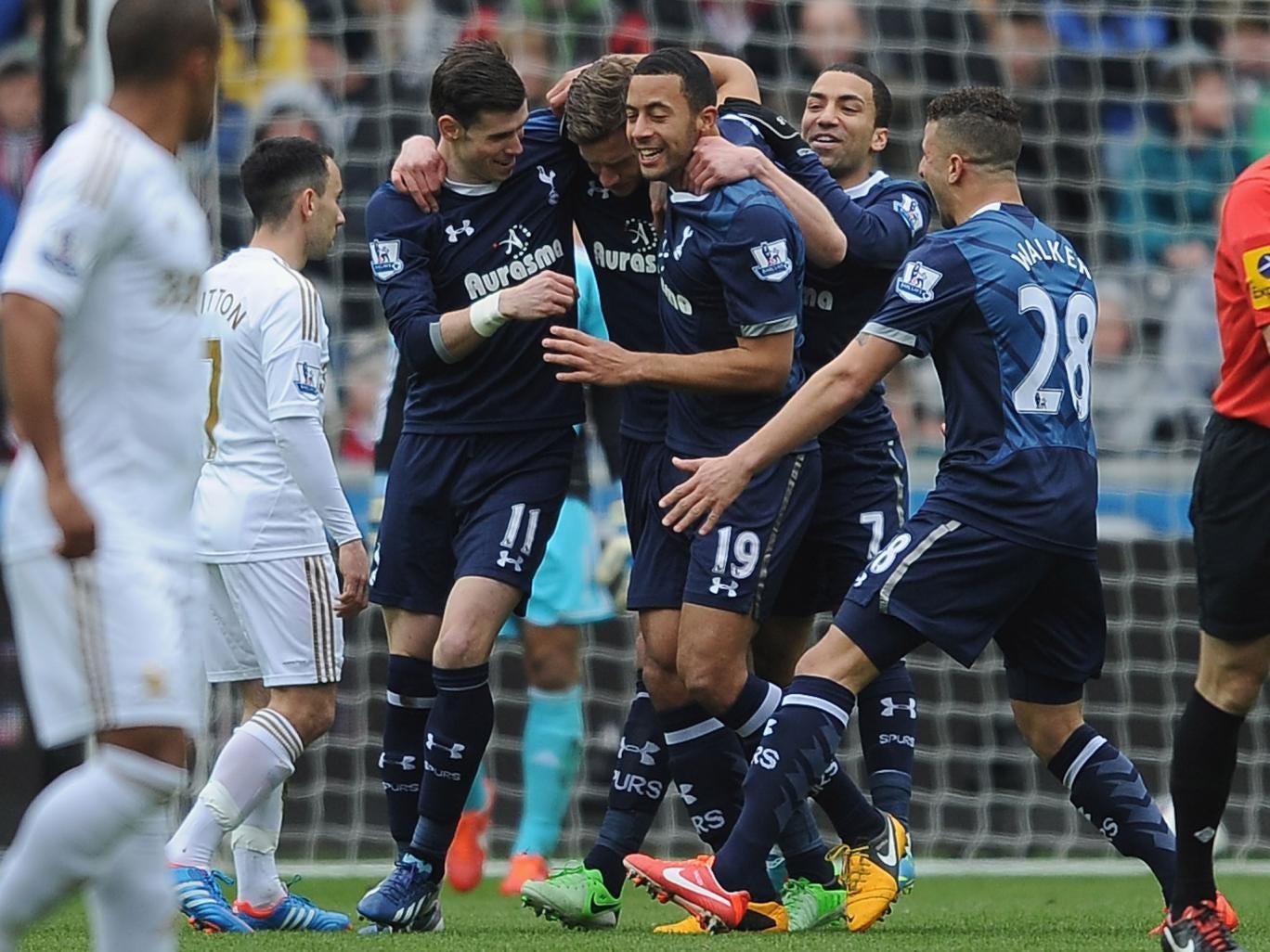 Jan Vertonghen of Tottenham celebrates with team-mates after scoring their first goal