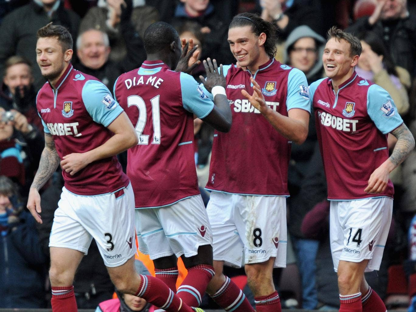 Andy Carroll of West Ham United (C) celebrates scoring his second goal