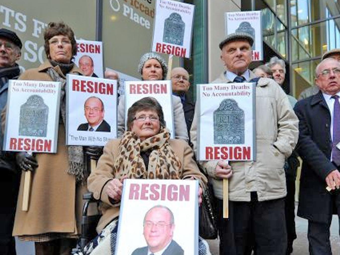 Protesters in London demand that Sir David Nicholson go