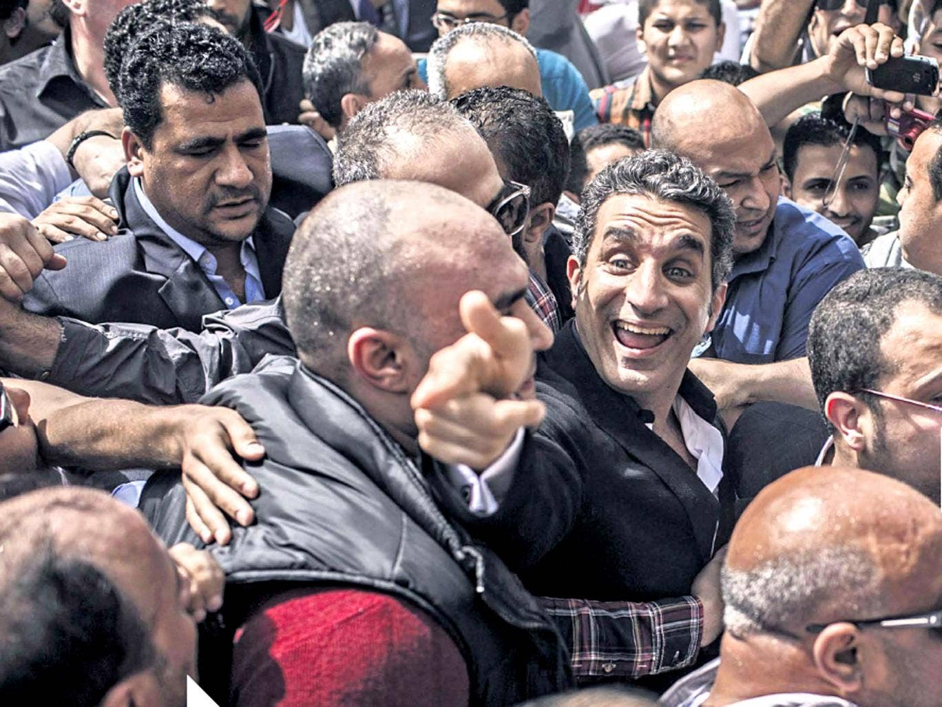 The comic Bassem Youssef arrives at court in Cairo today in what has been termed a political witch-hun