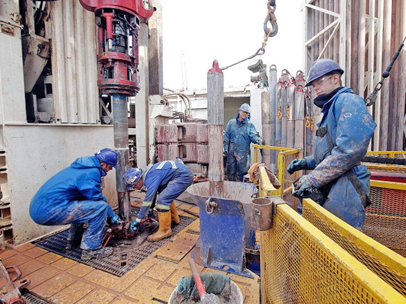 Engineers working on the drilling platform of the Cuadrilla shale fracking facility in Preston, Lancashire