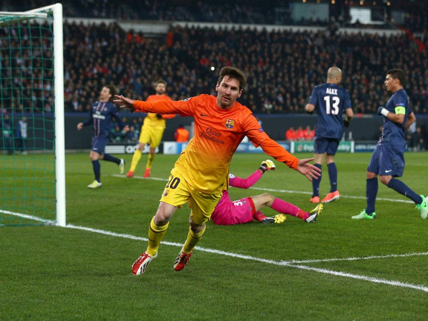 Barcelona forward Lionel Messi scores against PSG in the Champions League