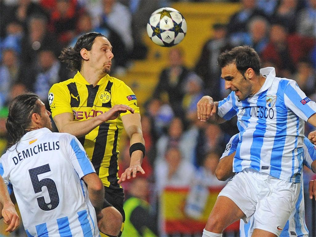 Dortmund's Neven Subotic vies with Malaga's Jesus Gamez