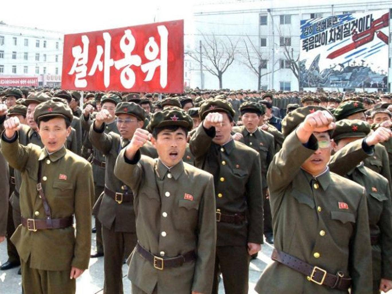 North Koreans attend a rally against the US and South Korea in Nampo yesterday
