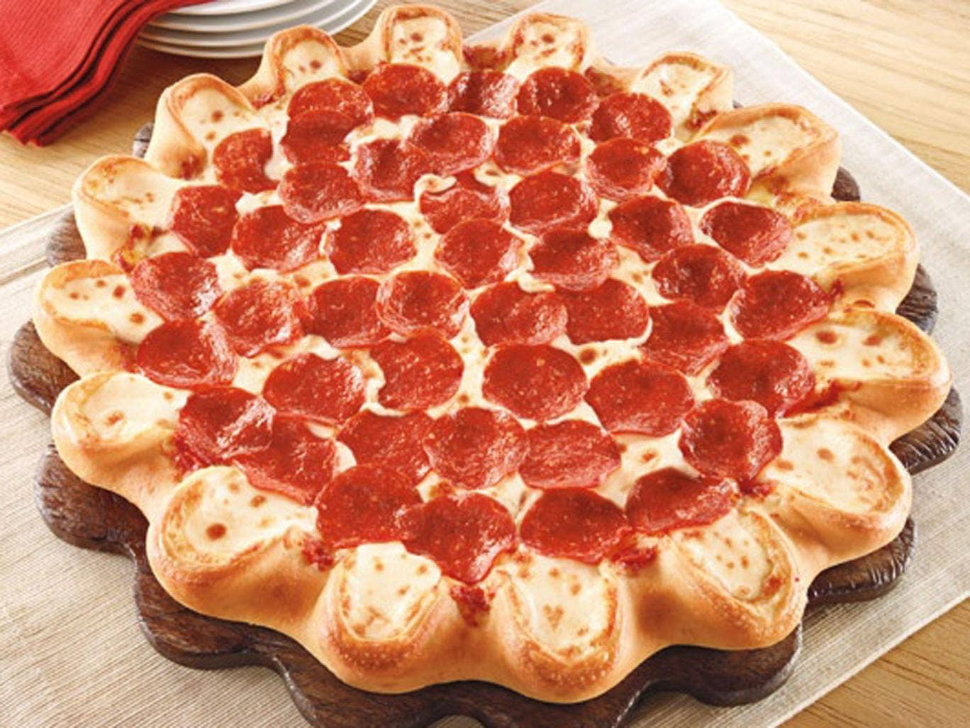 Pizza Hut's new pizza has handmade pockets of molten mozzarella, provolone, fontina, mild cheddar and other cheeses around the rim.