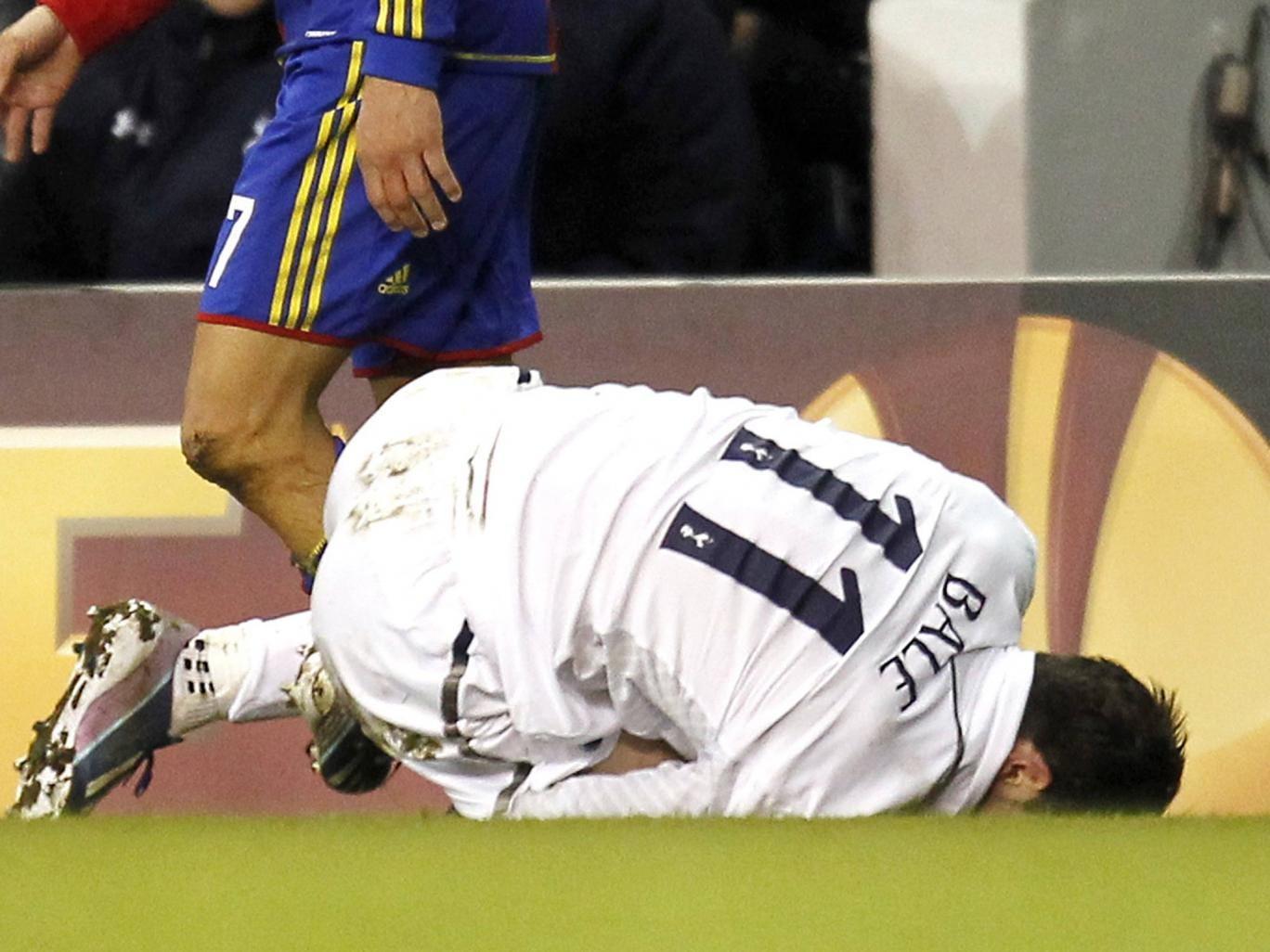 Gareth Bale goes down injured