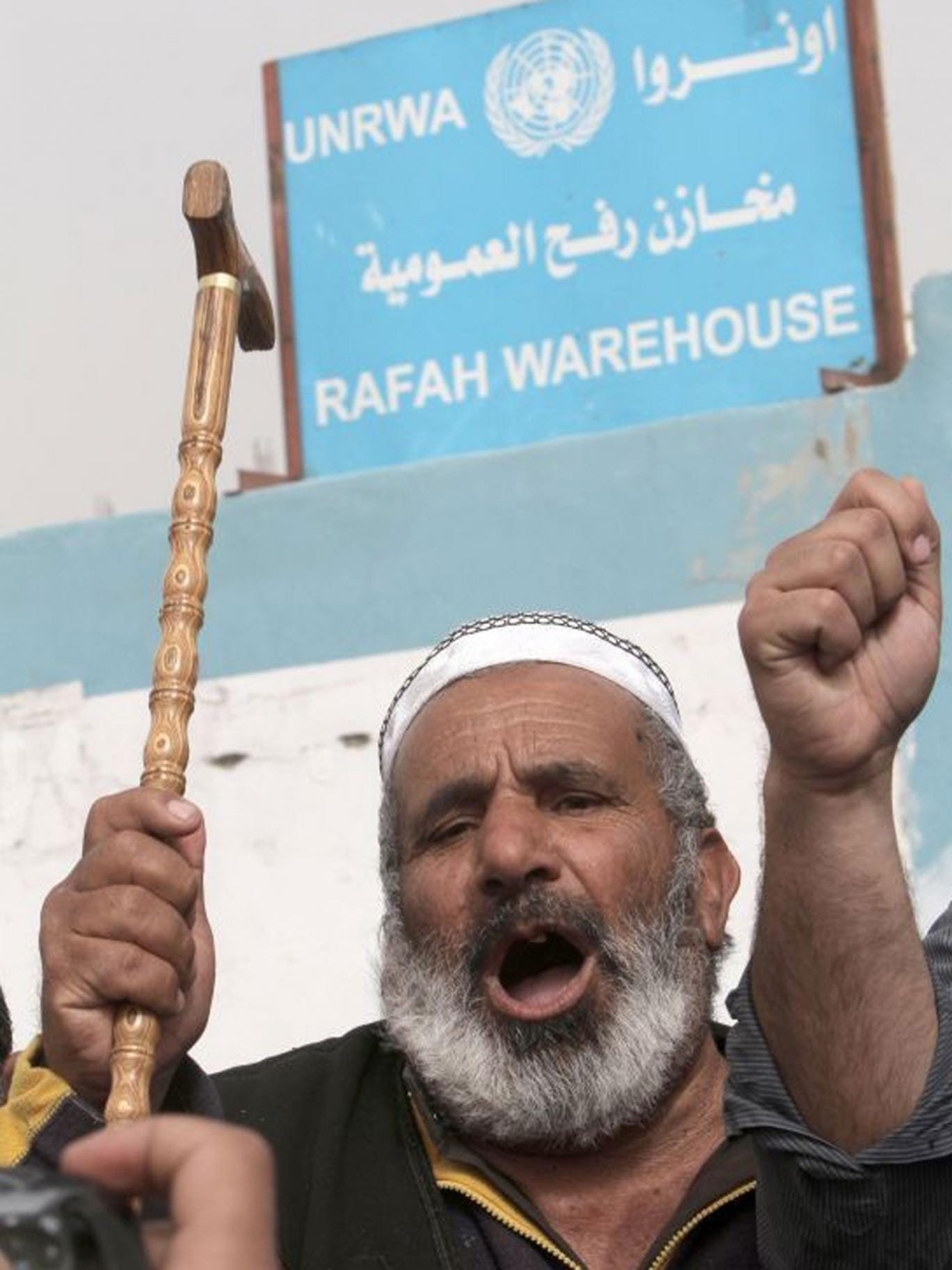 A Palestinian man protests against the reduction of some of the financial and food aid services given by the United Nations Relief and Works Agency
