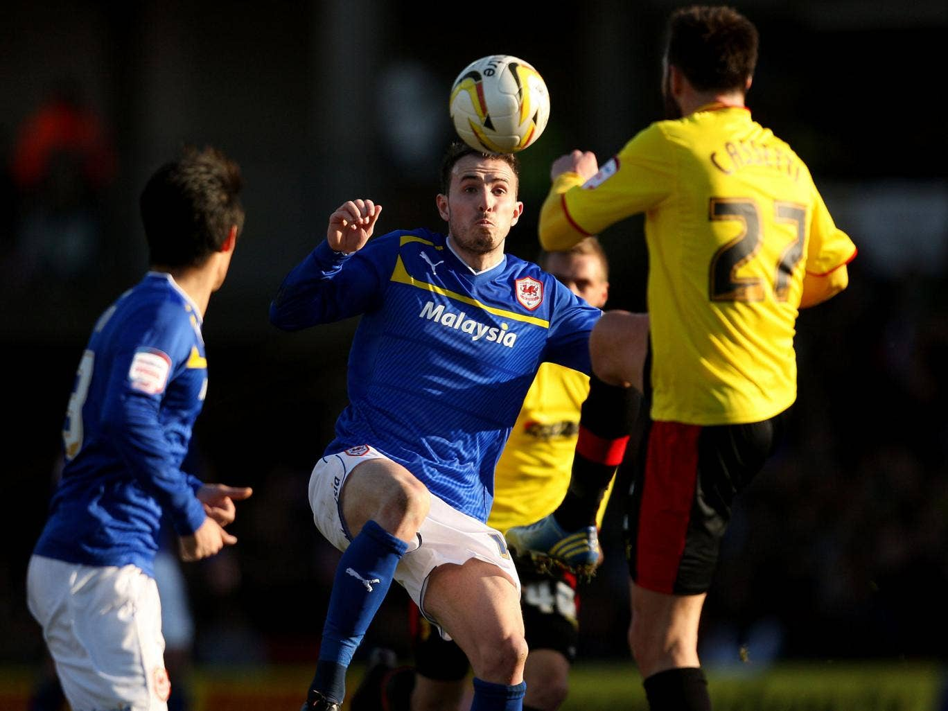 Kneesy does it: Mutch of Cardiff (left) tangles with Watford's Cassetti