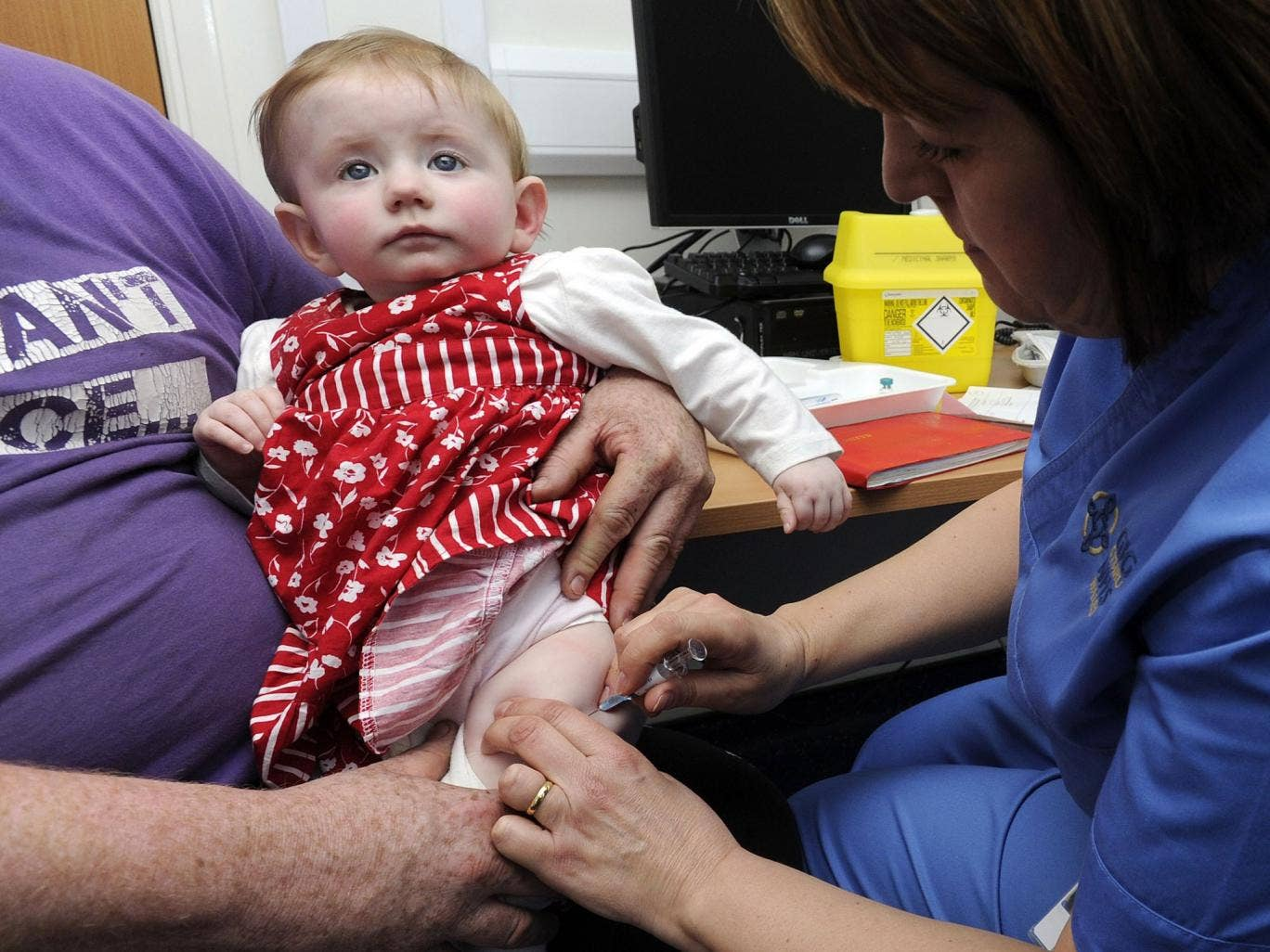 A 10-month-old girl has the MMR jab in Swansea yesterday