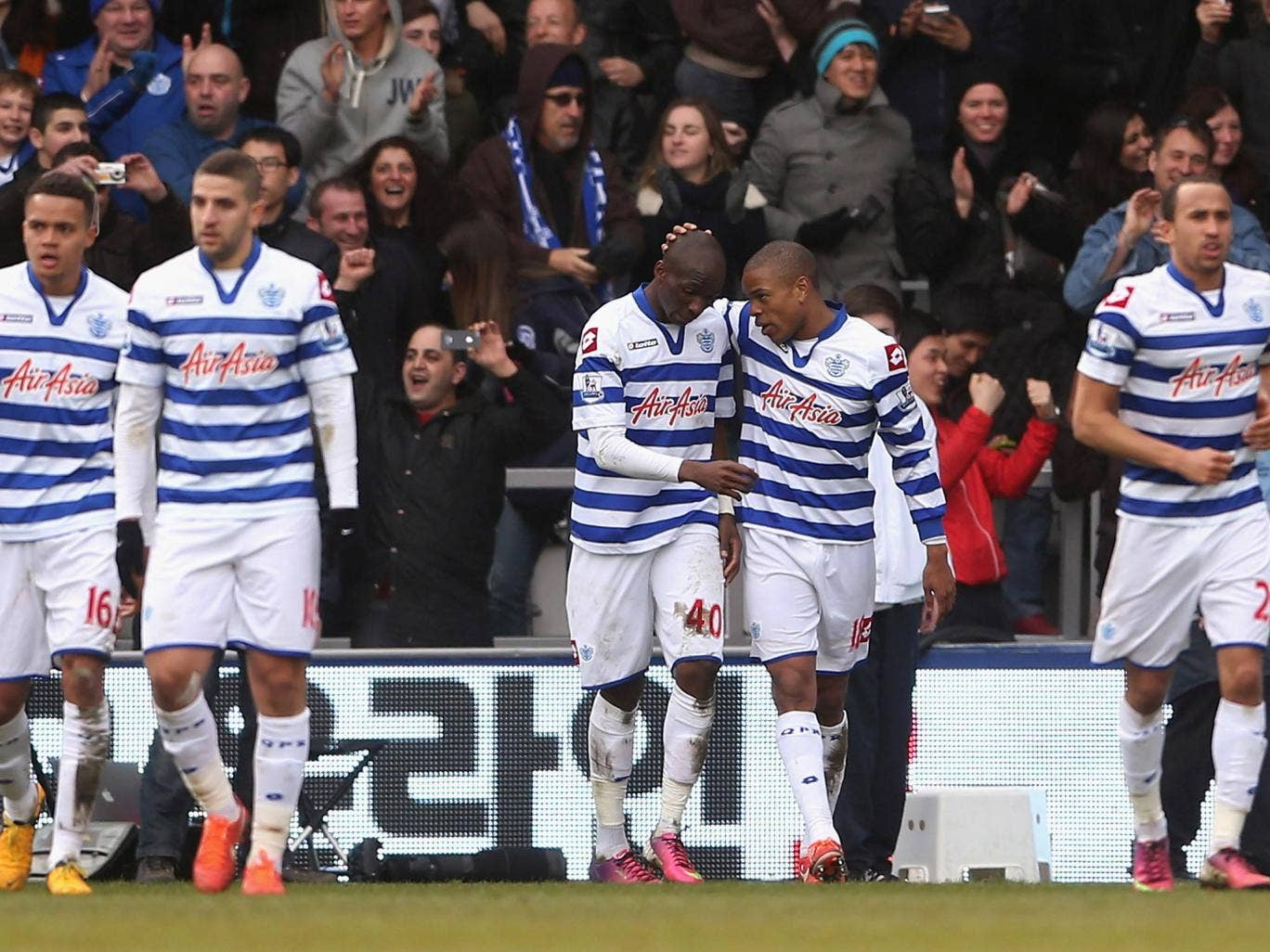 Loic Remy celebrates after scoring for QPR against Wigan