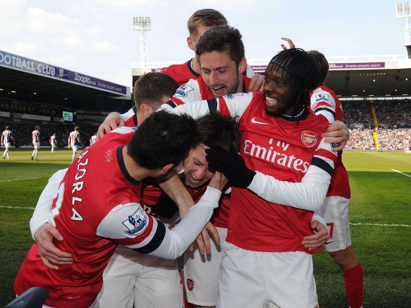 Tomas Rosicky celebrates scoring against West Brom with Arsenal team-mates Santi Cazorla, Aaron Ramsey, Per Mertesacker, Olivier Giroud and Gervinho