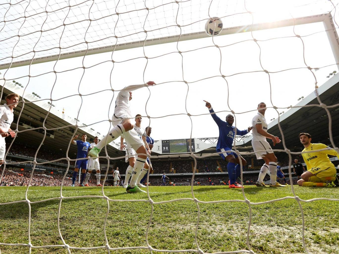 Victor Anichebe of Everton celebrates as Phil Jagielka of Everton (not pictured) scores their first goal against Tottenham