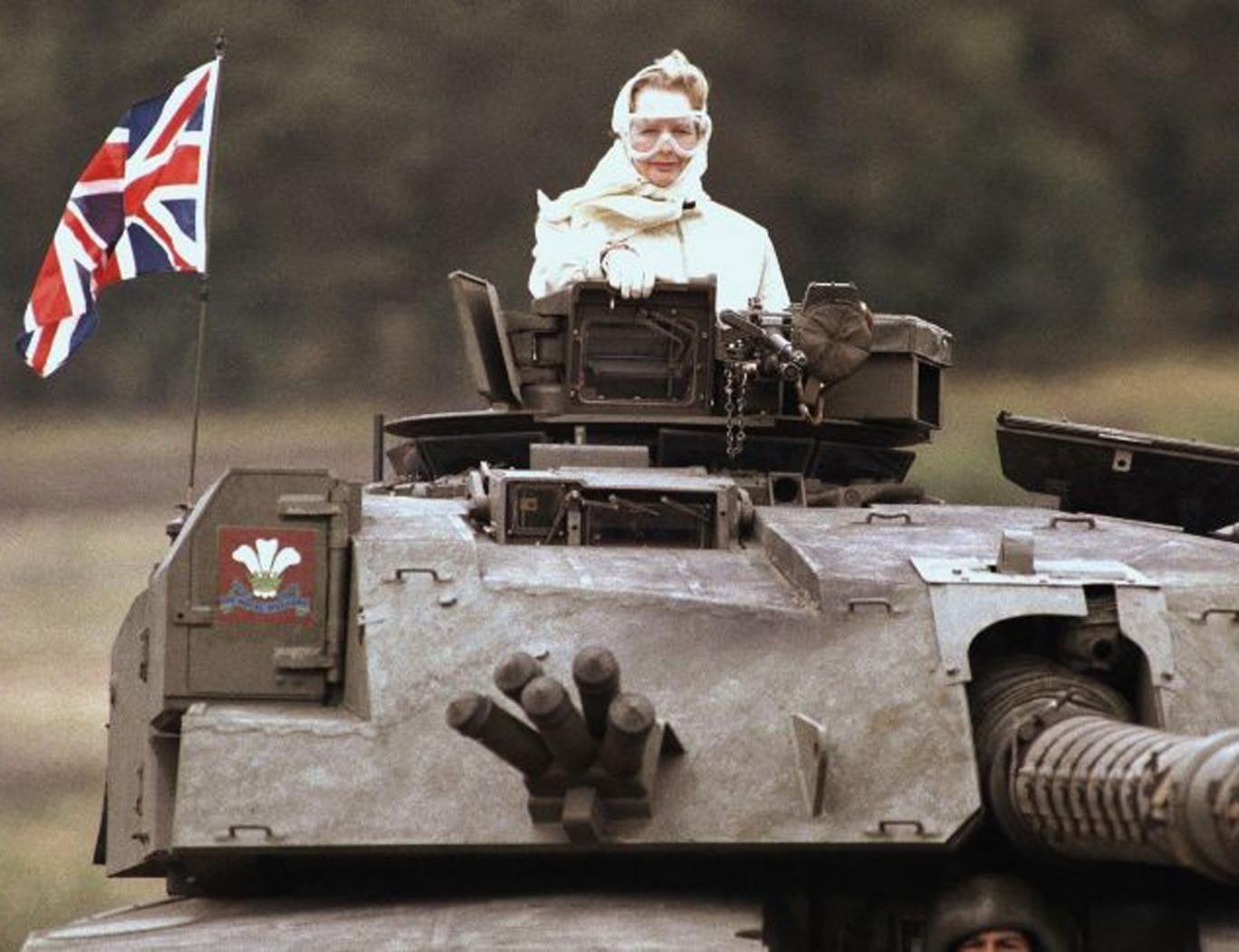 Margaret Thatcher stands in a British tank