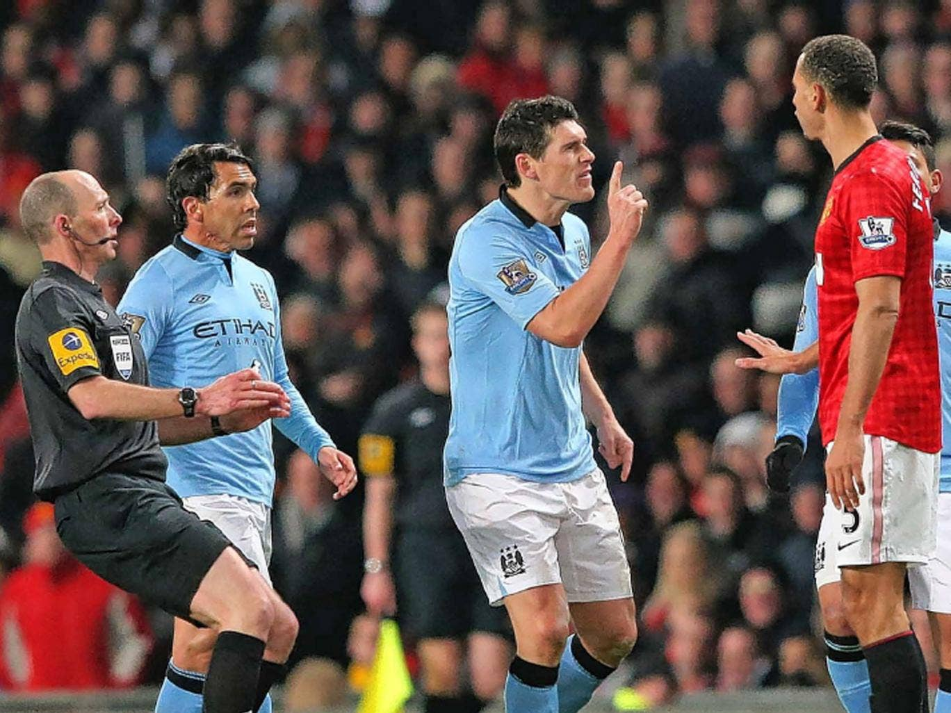 Gareth Barry and Rio Ferdinand square up to each other as tensions rise