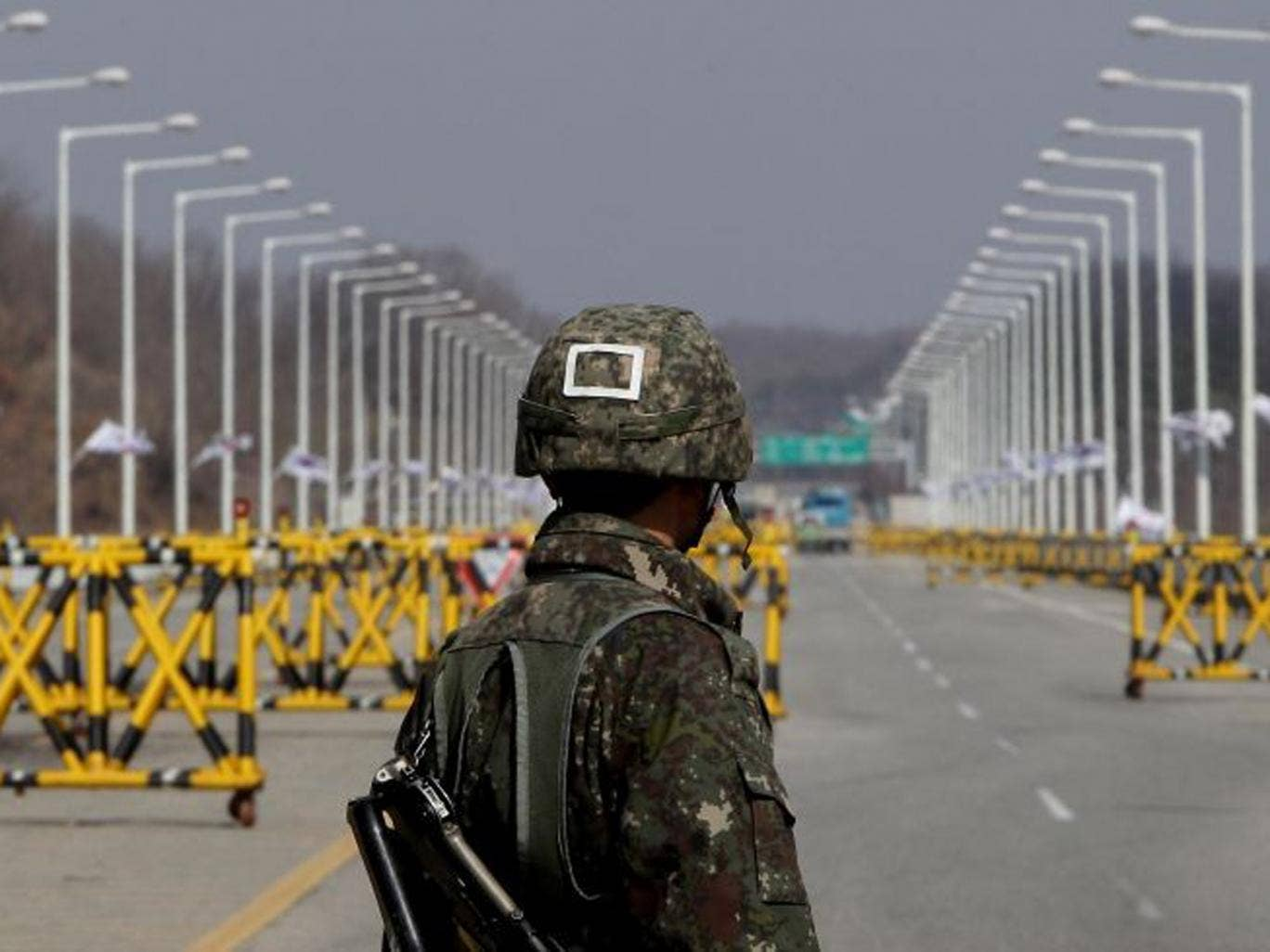 A South Korean soldier stands at a military check point connecting South and North Korea at the Unification Bridge in Paju, South Korea