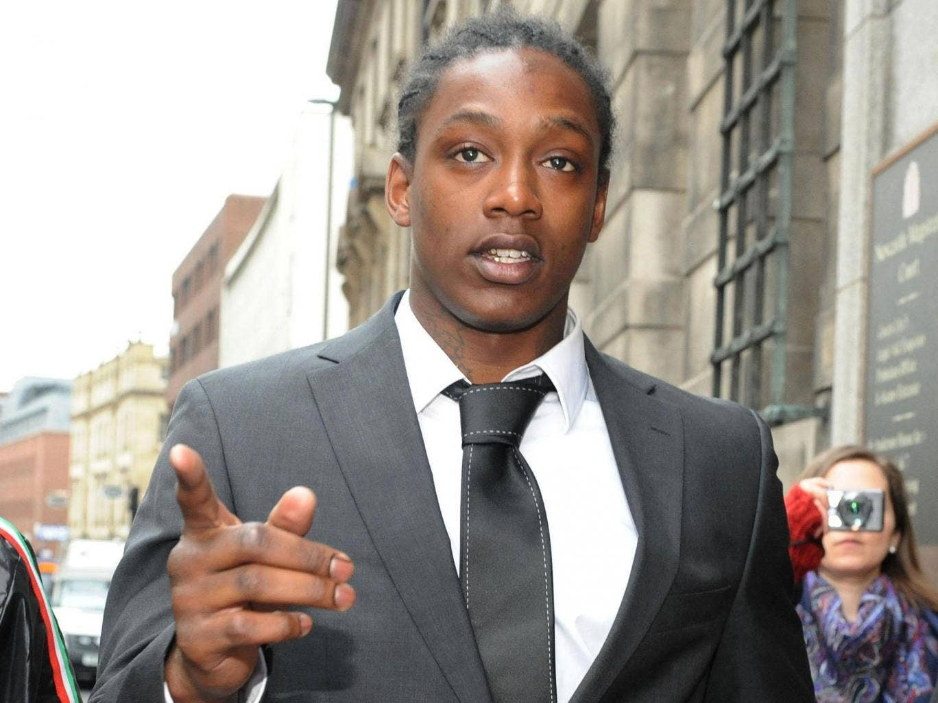Troubled ex-Premier League striker Nile Ranger was handed a 12- month community order today for pulling his girlfriend's hair during a row