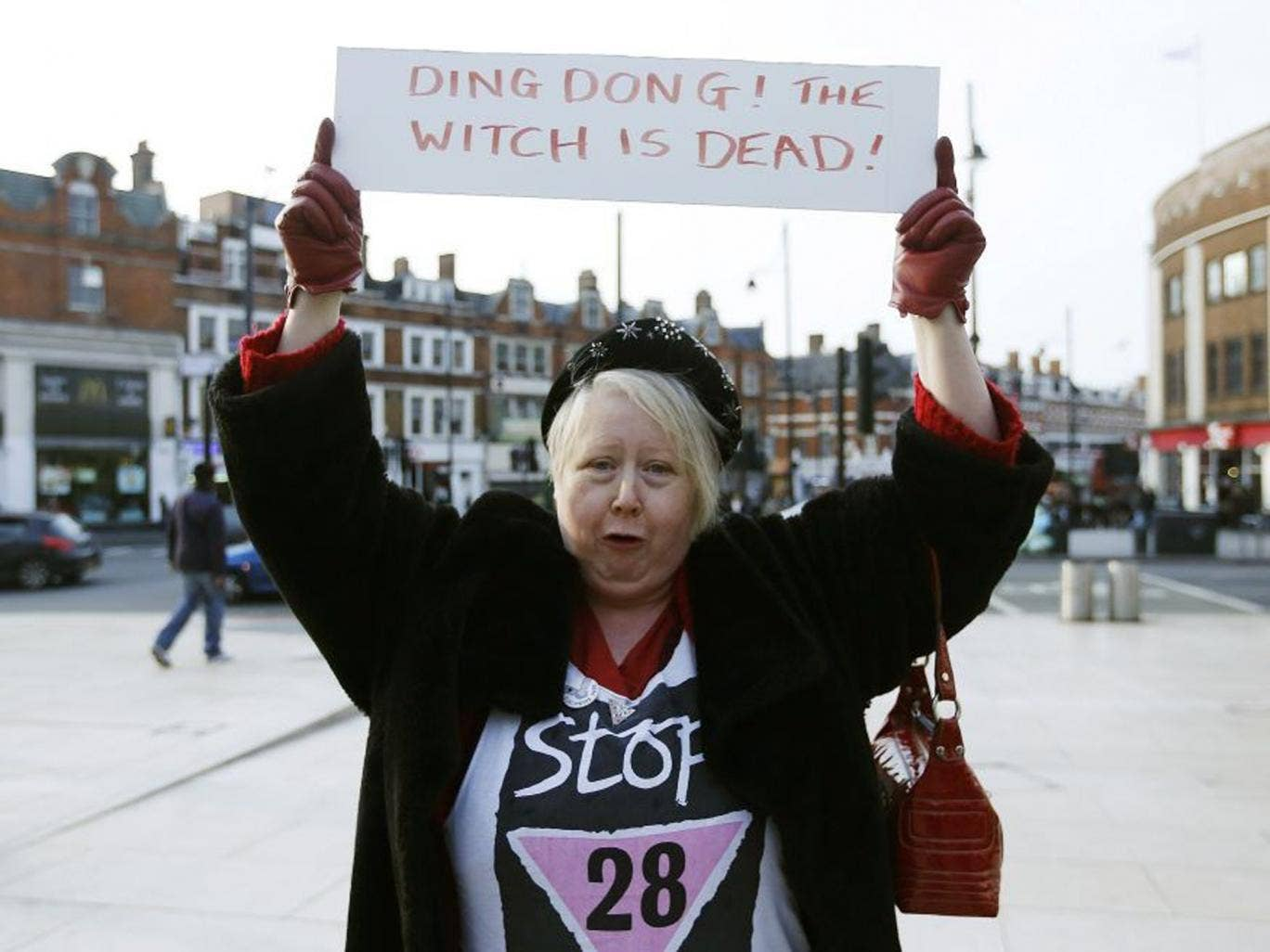 A reveller holds a sign to celebrate the death of Britain's former prime minister Margaret Thatcher