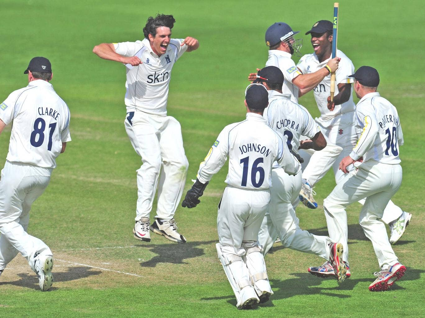 Chris Wright (second from left) and his Warwickshire teammates celebrate becoming County Champions last year