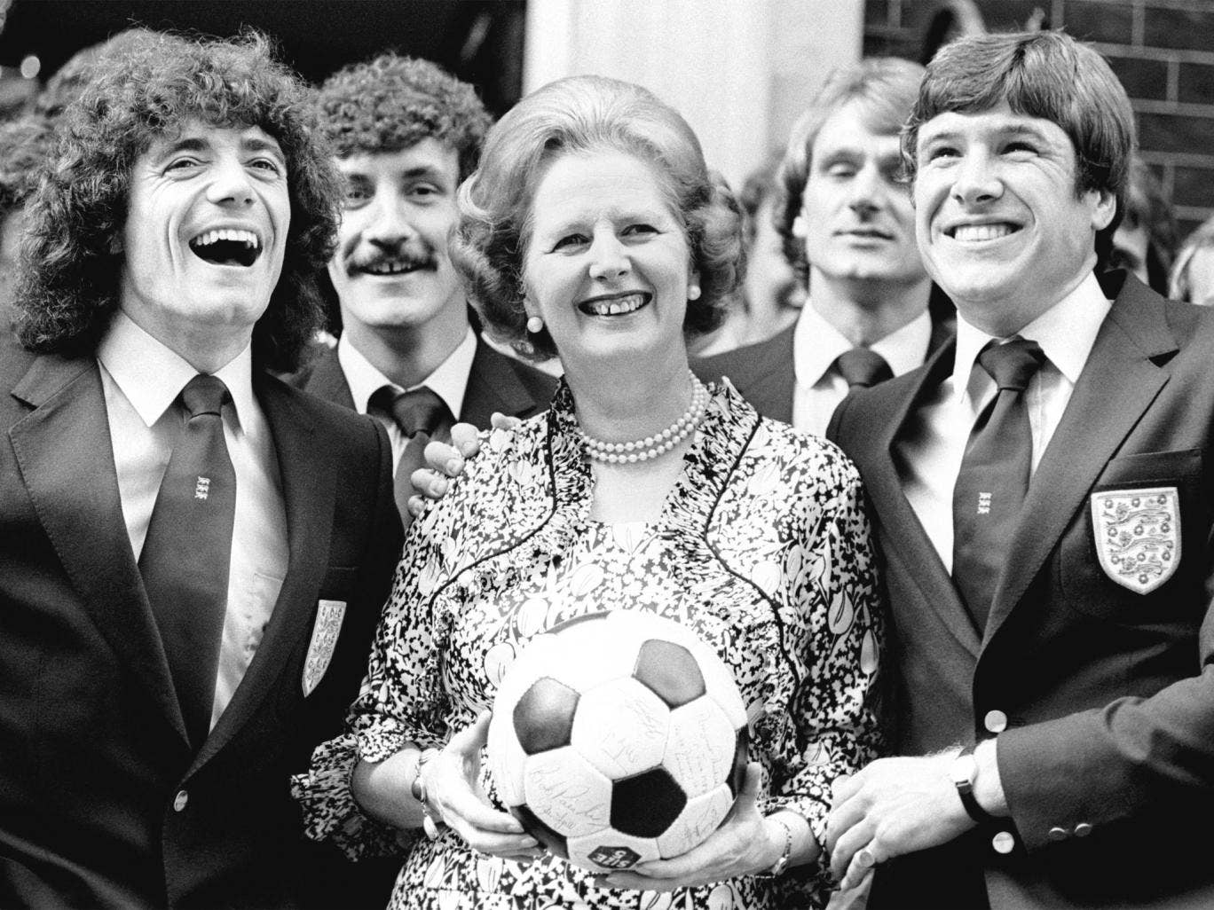 Margaret Thatcher takes advantage of a photo opportunity with Kevin Keegan (left), Emlyn Hughes and the rest of the England team of 1980