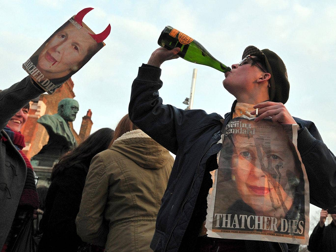 People gather during a 'party' to celebrate the death of former British Prime Minister Margaret Thatcher in London