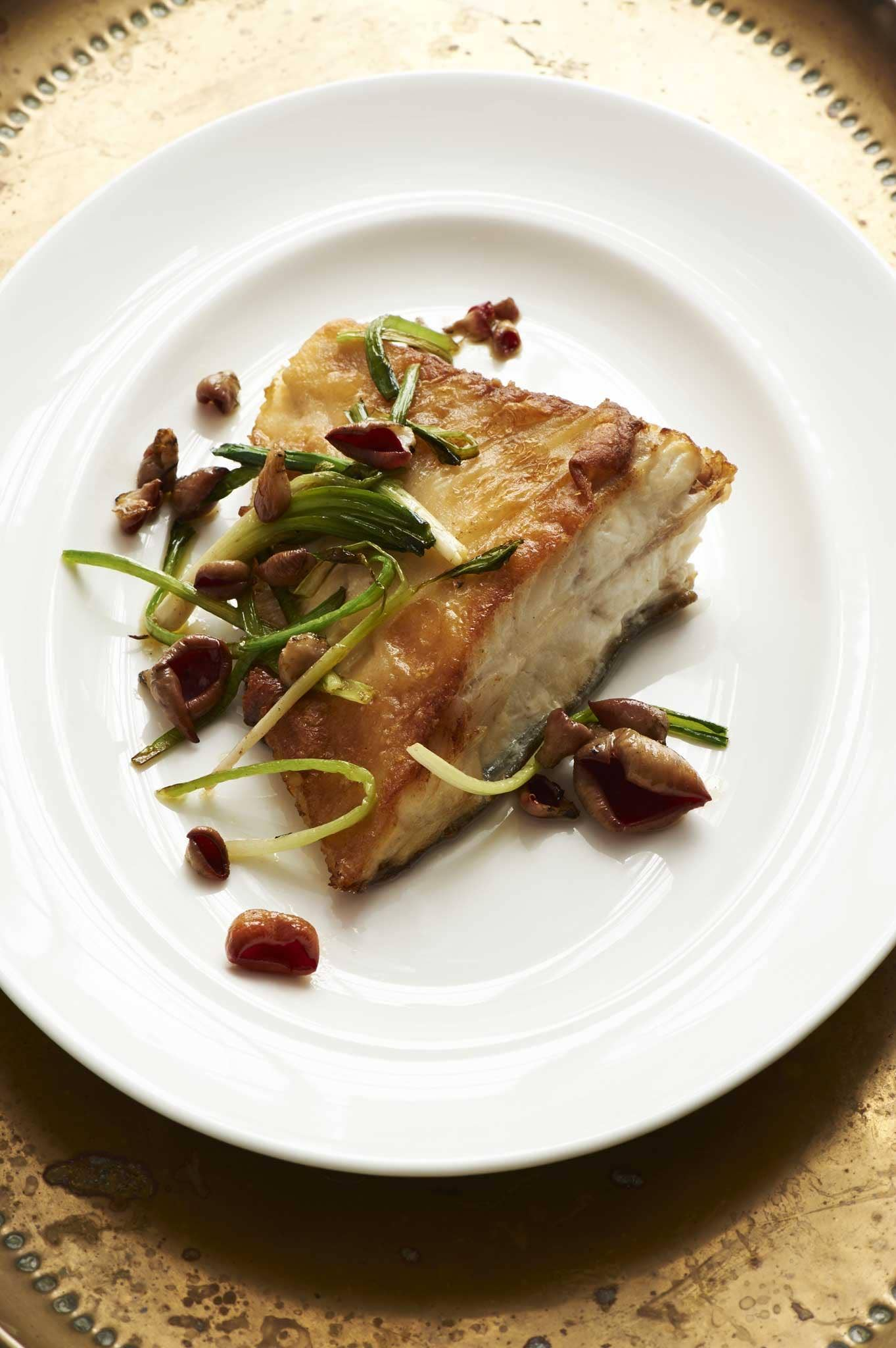 Roast turbot with garlic shoots and scarlet elf cups