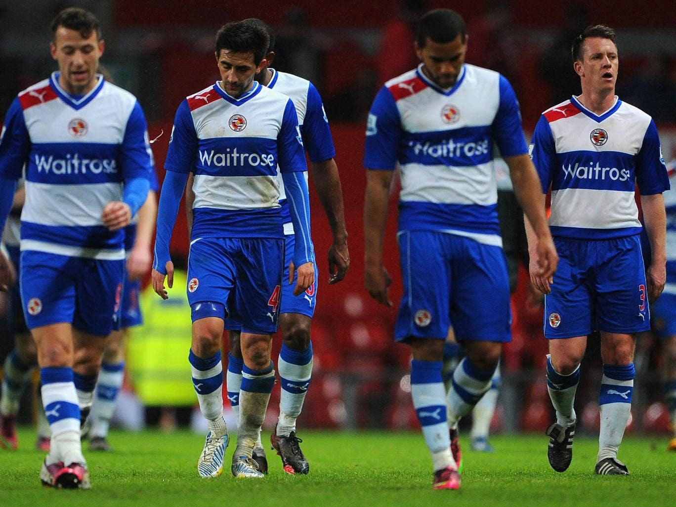 Reading players look dejected after their recent defeat against Manchester United at Old Trafford in the Premier League