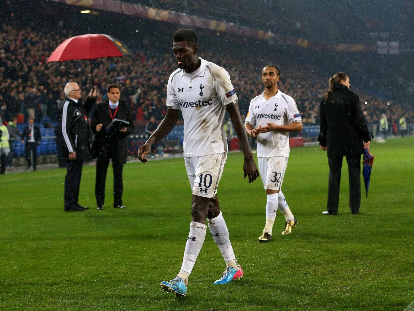 Emmanuel Adebayor leaves the pitch in Basel after defeat on penalties