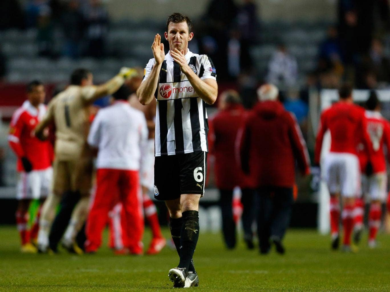 Mike Williamson of Newcastle applauds the home fans