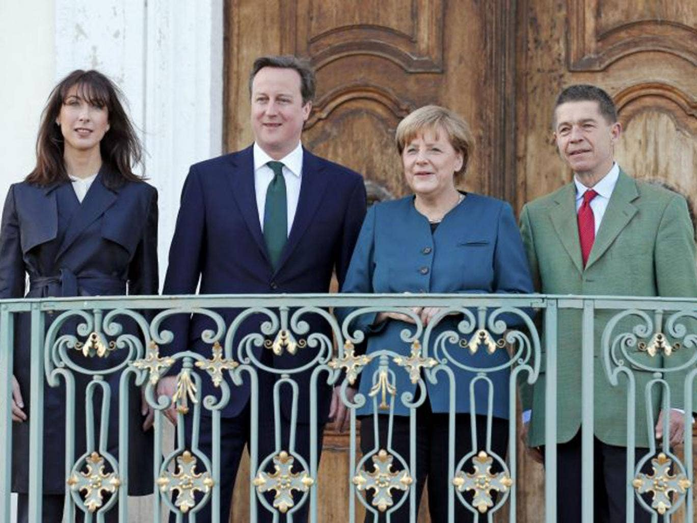 German Chancellor Angela Merkel and her husband Joachim Sauer (R) welcome Britain's Prime Minister David Cameron and his wife Samantha (L) at the government's guest house Schloss Meseberg