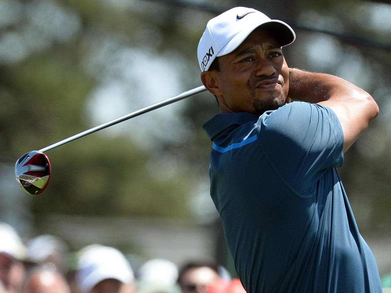 Tiger Woods teed off mired in a rules controversy after taking an incorrect drop on Friday