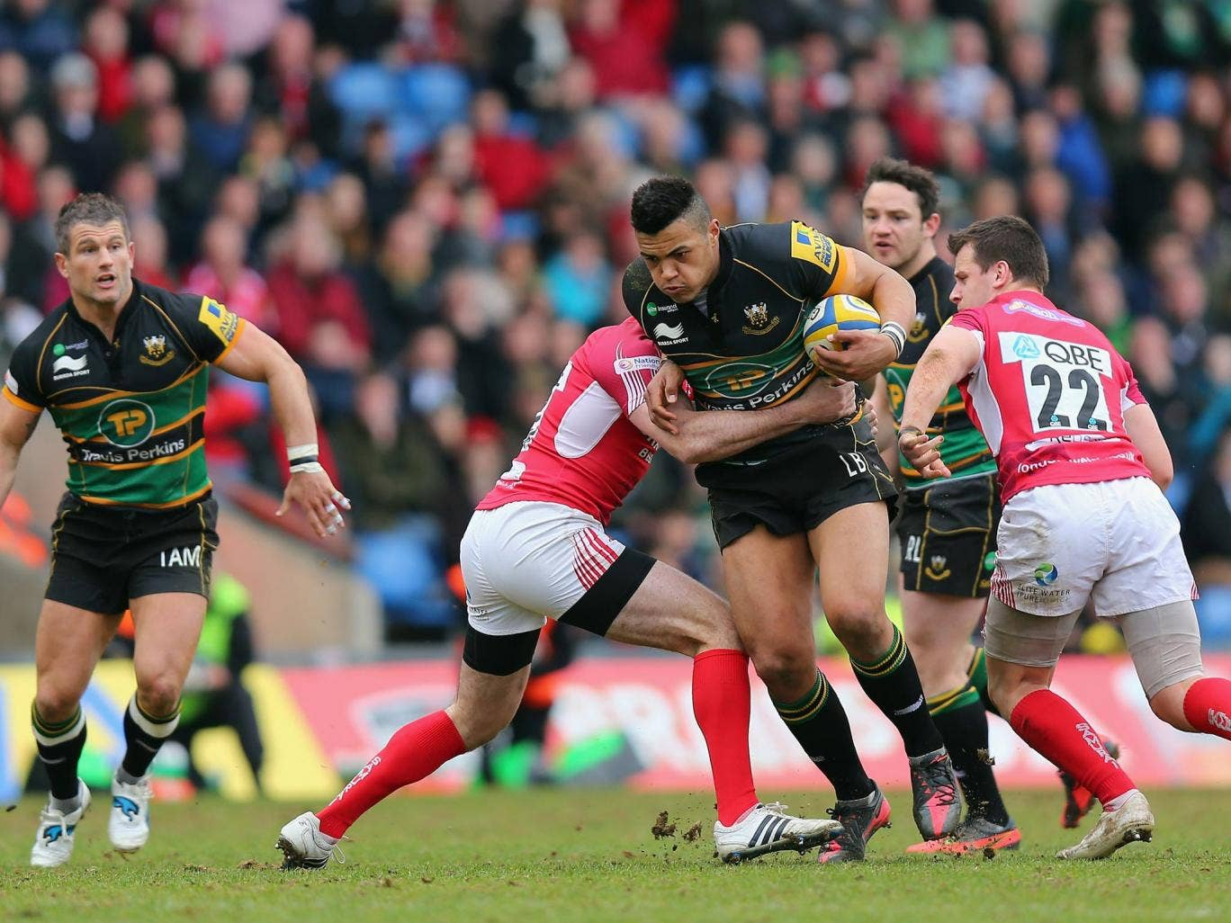 Luther Burrell of Northampton is tackled by Tom Voyce of London Welsh