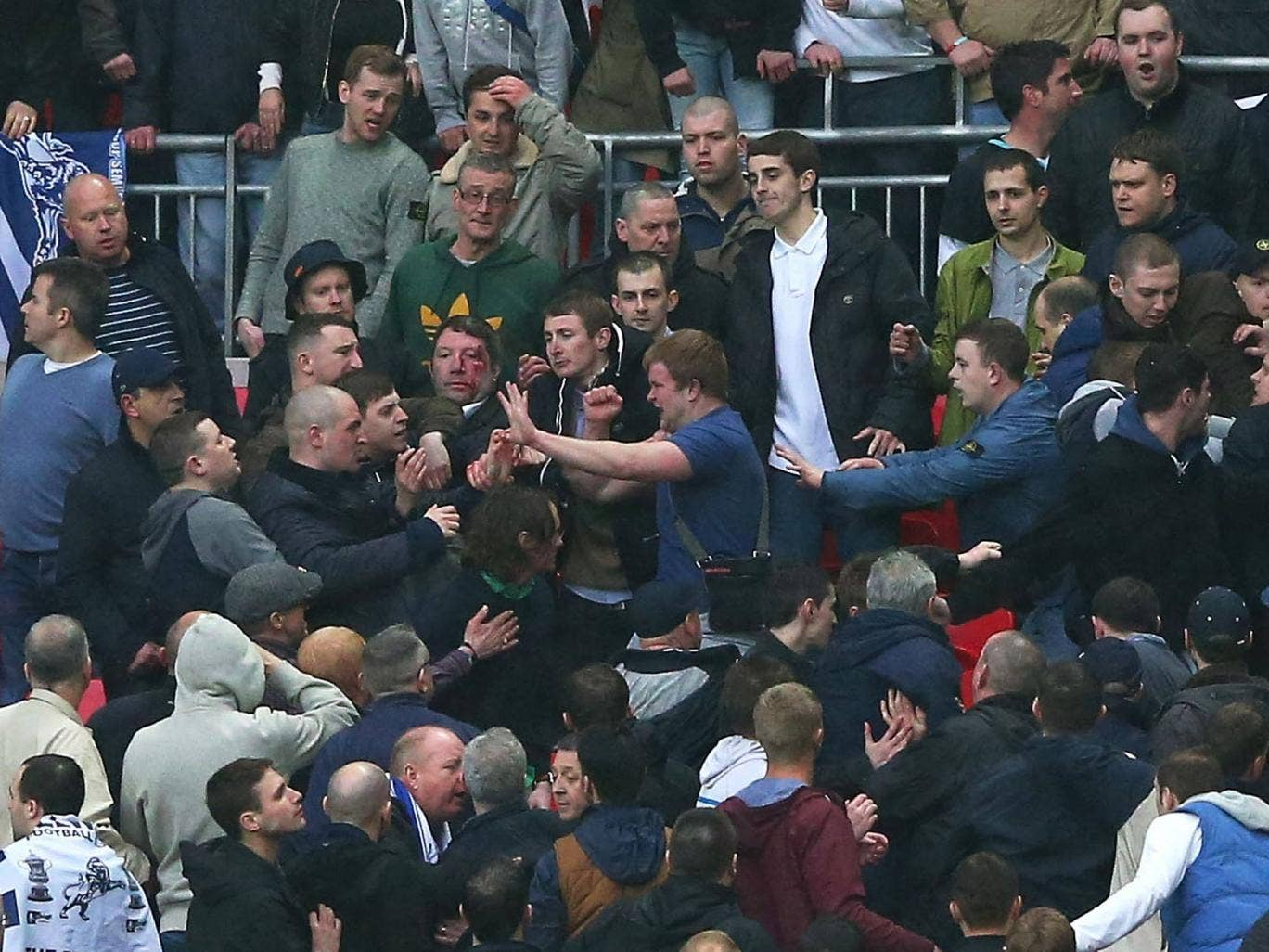 Millwall fans pictured fighting at Wembley