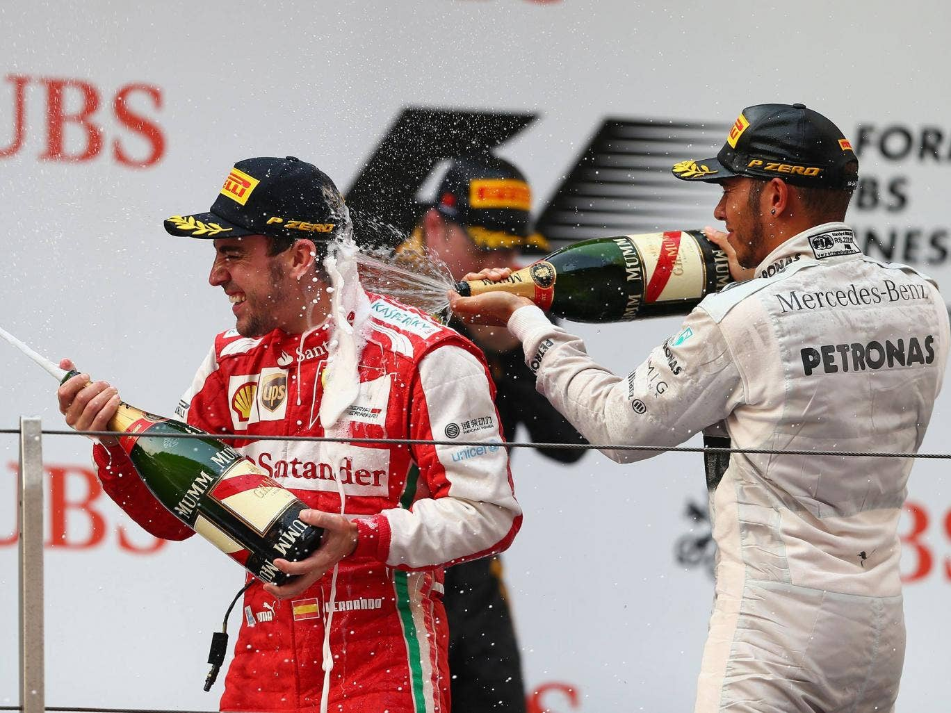 Fernando Alonso celebrates victory at the Chinese Grand Prix