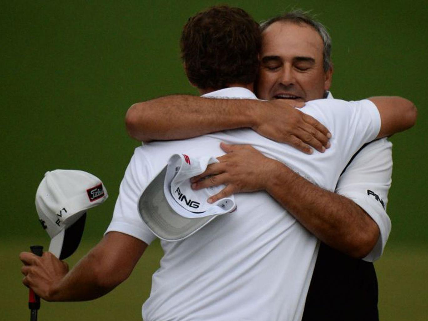 Angel Cabrera congratulates Adam Scott on winning the Masters