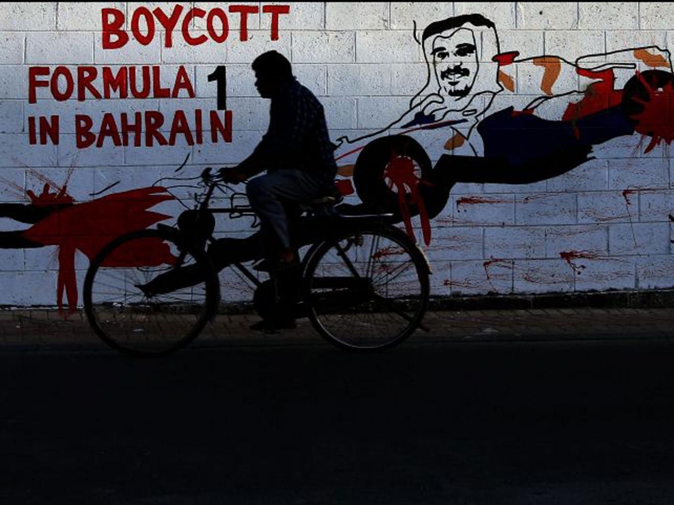 Graffiti in Bharain shows Crown Prince Salman Al Khalifa in a racing car with blood on its wheels
