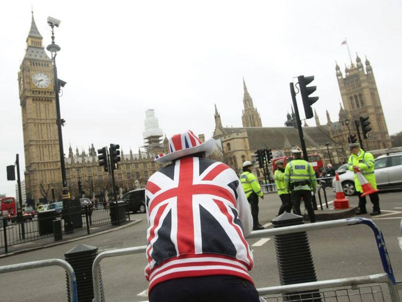A Thatcher supporter looks across at the Houses of Parliament this morning ahead of her funeral