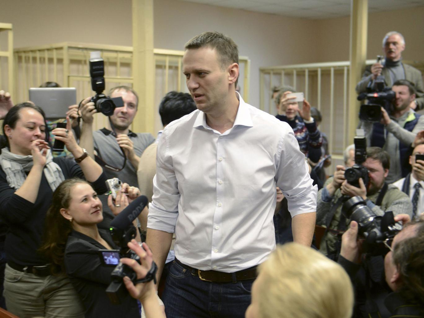 Alexei Navalny enters the courtroom in Kirov