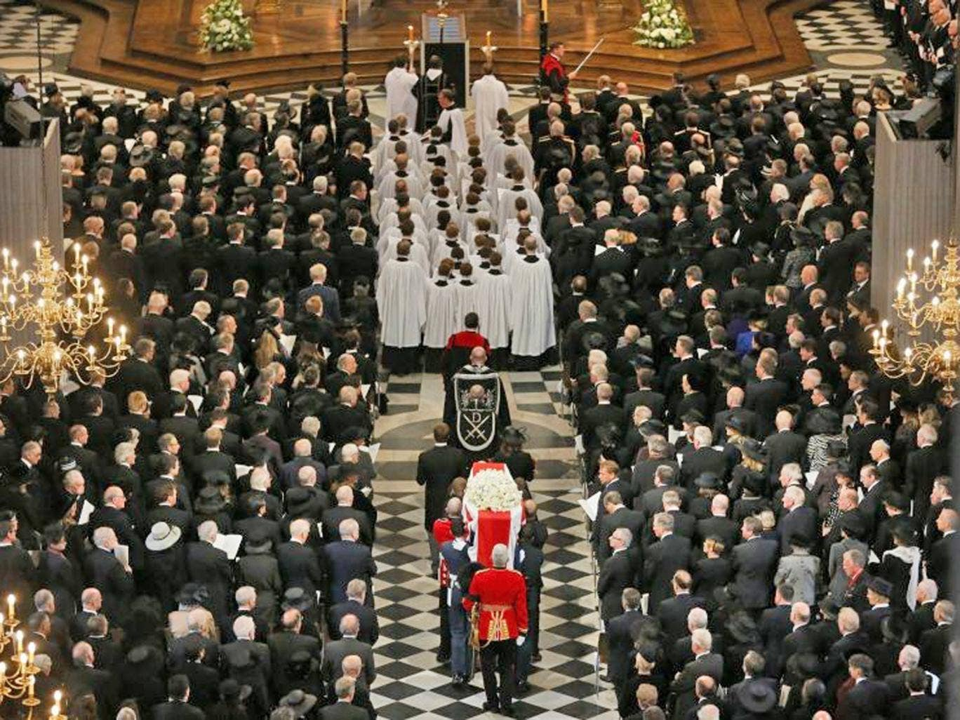The coffin of former British prime minister Margaret Thatcher is carried by the Bearer Party as it arrives for her funeral service at St Paul's Cathedral