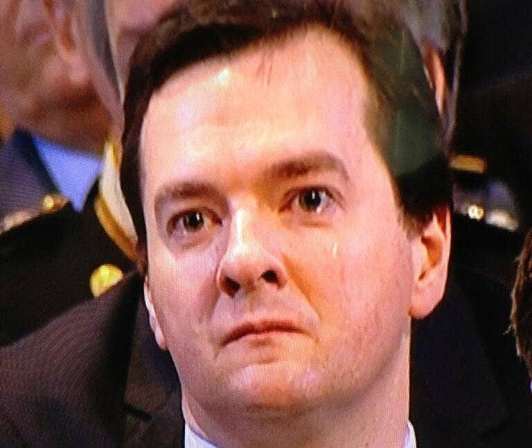 George Osborne appears to be crying and is seen wiping away a tear during the service