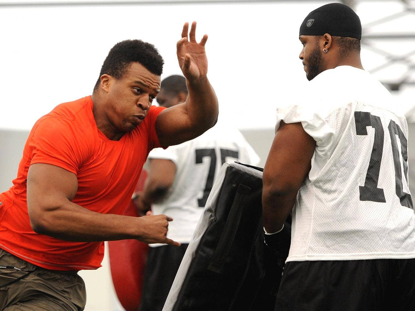 Lawrence Okoye takes part in activities during the NFL Media Day at the London Soccerdome on Tuesday