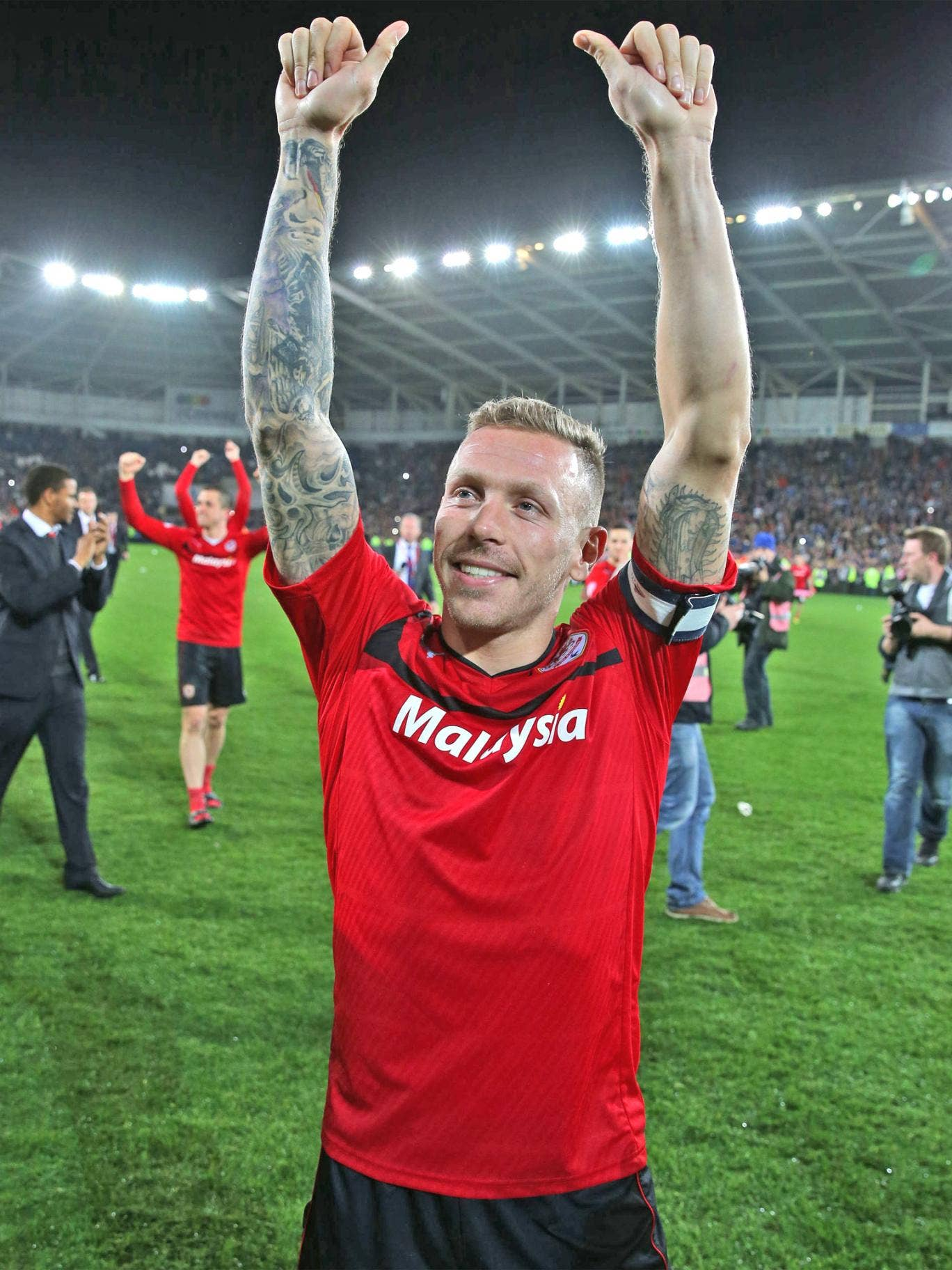 Craig Bellamy celebrates Cardiff being promoted to the Premier League