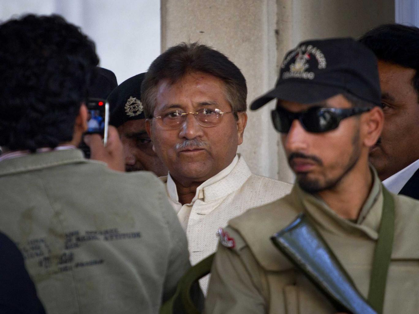 Pakistan's former president and military ruler Pervez Musharraf, centre, leaves court