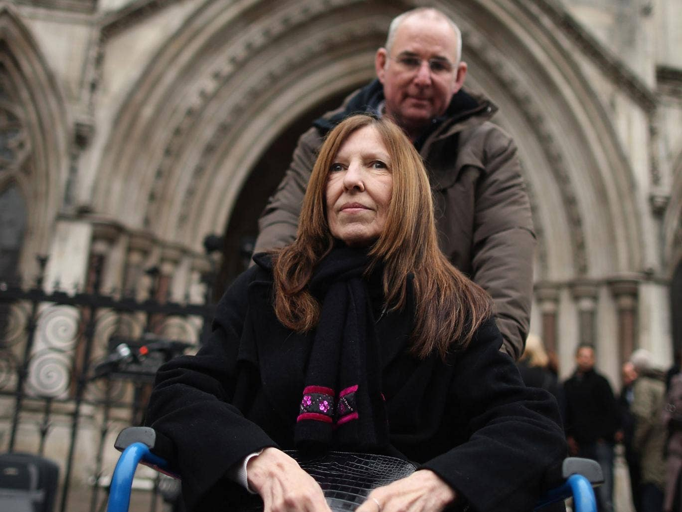 Williams arrives with a friend at the High Court in London last December to hear all 96 Hillsborough inquest verdicts quashed