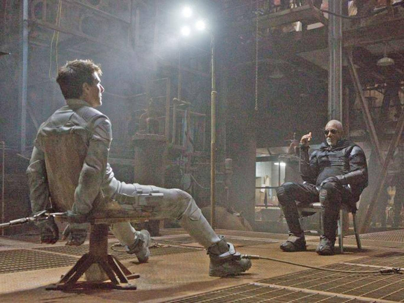 Tom Cruise, left, and Morgan Freeman in a scene from 'Oblivion'