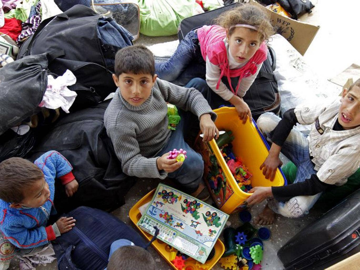 Syrian refugees with toys from the UAE